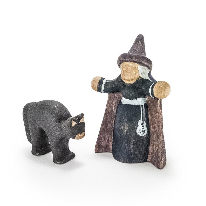 wooden toy witch with black cat